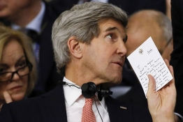U.S. Secretary of State John Kerry holds a note as he attends the Conference on International Support to Libya in Rome.