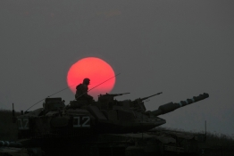An Israeli tank manoeuvres outside the northern Gaza Strip.