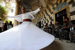A whirling dervish performs a traditional Sufi dance in the Tekkiye Suleimaniye mosque complex in Damascus.