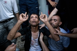 A Palestinian father reacts at the Shifa hospital morgue after his son was killed in an explosion.