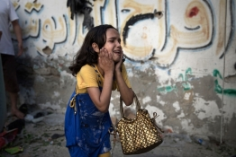 A Palestinian girl reacts at the scene of an explosion.