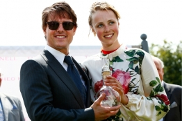 Hollywood actor Tom Cruise presents an award to supermodel Edie Campbell after she won a Ladies charity race at Goodwood racecourse.