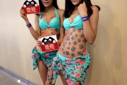 Models with an internet company's quick response (QR) codes promote at the 13th China Internet Conference in Beijing.