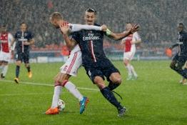 Paris St Germain's Zlatan Ibrahimovic challenges Ajax Amsterdam's Mark van der Hoorn.